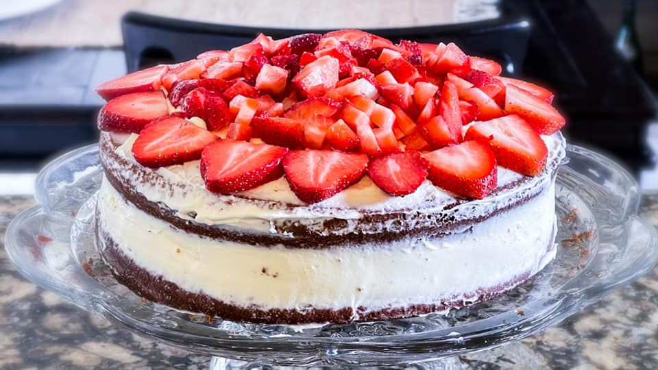 Layered almond cake with strawberries on top.