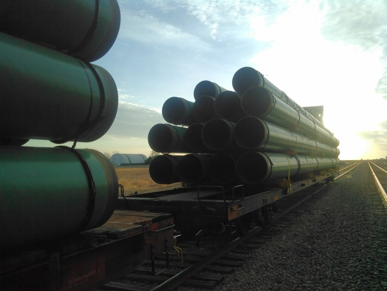 Pipeline waiting on rail at Mina-Hwy212 junction, 2015.03.21