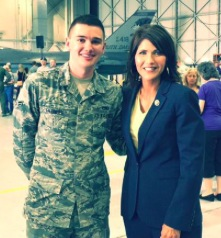 Rep. Kristi Noem with a member of the 114th Fighter Wing at its activation, Sioux Falls, South Dakota, May 3, 2015.