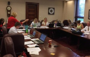 Secretary of State Shantel Krebs (in red) and team scrutinize SB 177 referendum petitions. Photo from @SOSKrebs, tweeted 2015.06.30