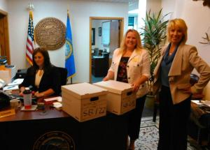 Secretary of State Shantel Krebs (right) and Deputy SOS Kea Warne (middle) receive petitions to refer SB 177 and SB 69. State Capitol, Pierre, South Dakota, 2015.06.29