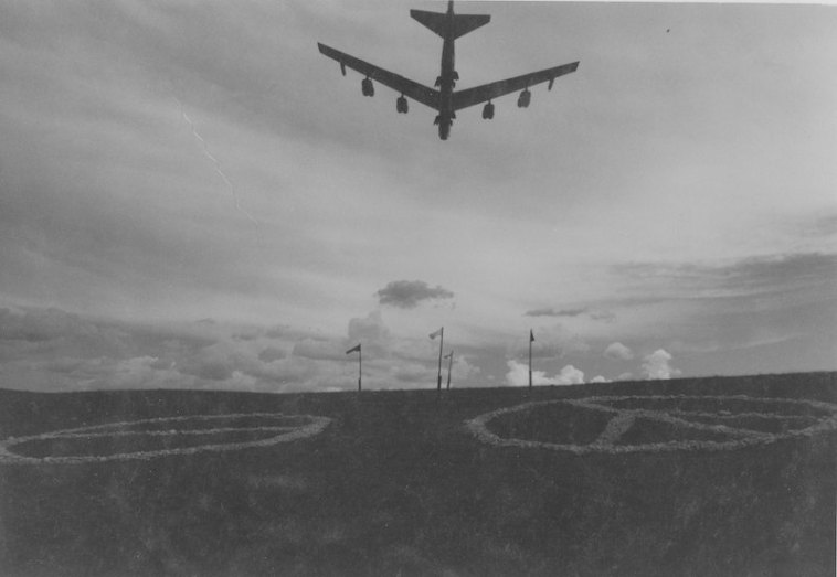B-52 from Ellsworth Air Force Base flies over rock protest symbols on Marvin Kammerer's Meade County ranch. Photo by Don Polovich, Rapid City Journal staff, 1980.