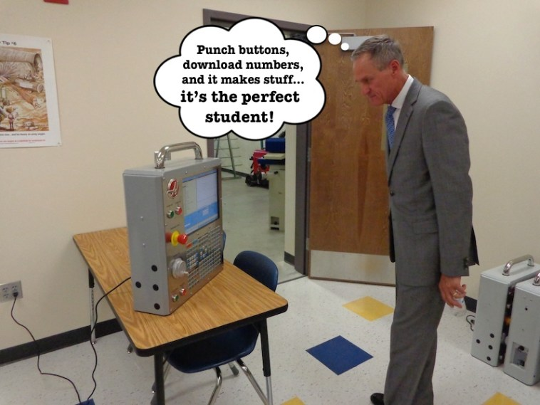 Governor Daugaard inspects CNC machine.