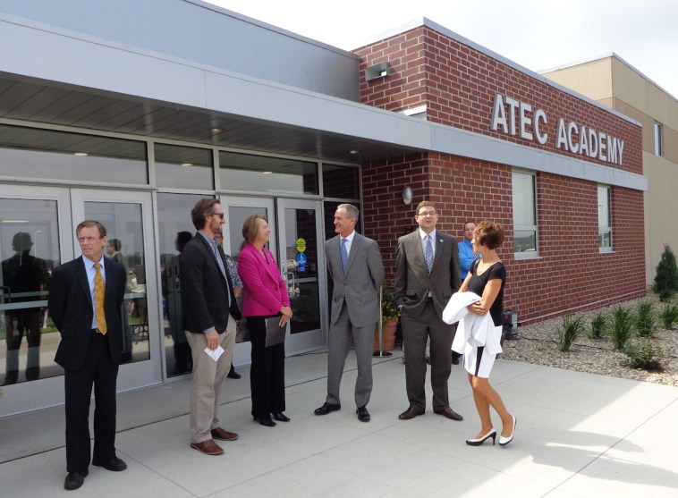 Mayor Mike Levsen, A-TEC lead architect Tom Hurlbert, Superintendent Becky Guffin, Governor Dennis Daugaard, chief of staff Tony Venhuizen, and Secretary of Education Melody Schopp discuss the new A-TEC Academy.