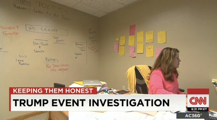 Screen cap from CNN showing Annette Bosworth's wall, scribbled with names and topics from her failed 2014 U.S. Senate campaign and the fallout, 2015.09.17.