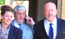 Dana Hanna, right, exits the Hughes County Courthouse with fellow attorney Robert Van Norman (center). (Photo by Phu Nguyen, Pierre Capital Journal, 2015.05.21.)