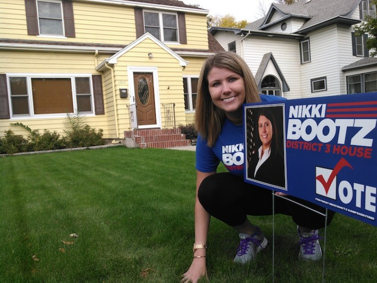 District 3 House candidate Nikki Bootz, in the blocks, ready to march, by a good friend and supporter's house on Main Street.