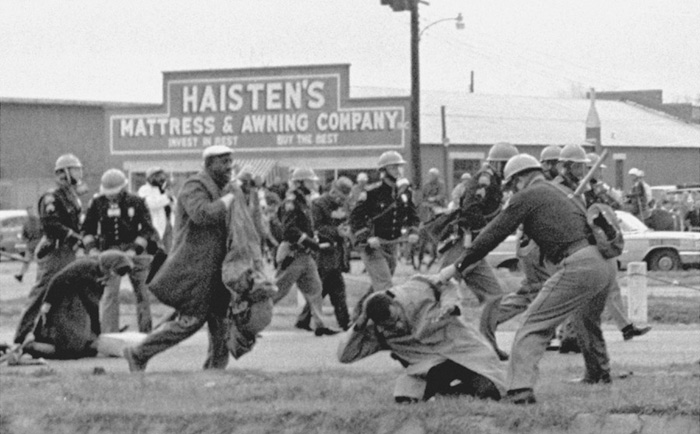 John Lewis (in the foreground) being beaten by state troopers, March 7, 1965—AP via The National Archives.