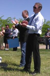 Max Sandlin and Bernie Hunhoff applaud Senator Sutton's speech.