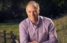 First official Bjorkman campaign photo: checked shirt, wood fence... ah, country living....