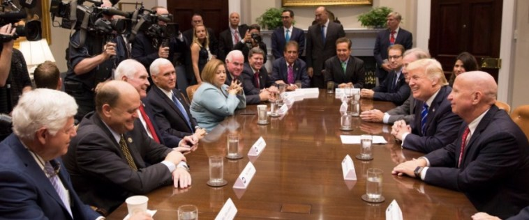 Rep. Kristi Noem sits back (upper right) at a White House meeting between Donald Trump and members of the House Ways and Means Committee; photo tweeted by @realdonaldtrump, 2017.09.26.