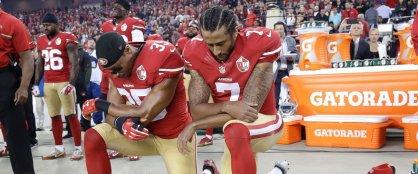 Colin Kaepernick kneel during anthem 09/12/2016 straightback cornrows