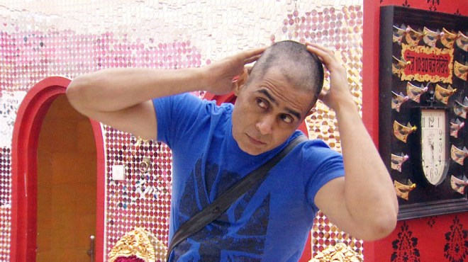 Aman Verma in his new bald avatar on Bigg Boss. (Image Courtesy - Colors)