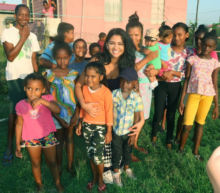 Kristal Inshan with village children near her hometown.