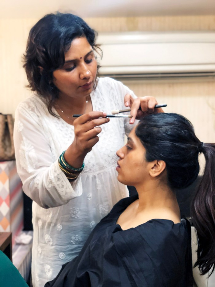 Preetisheel Singh working on Bhumi Pednekar's look on the sets of Bala. Pic 1.