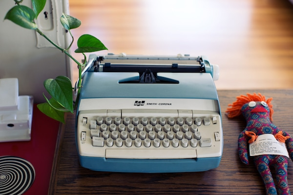 Photo of typewriter and doll