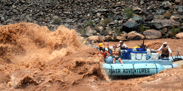 Hermit Rapid engulfs our raft. Copyright Donnelle Oxley