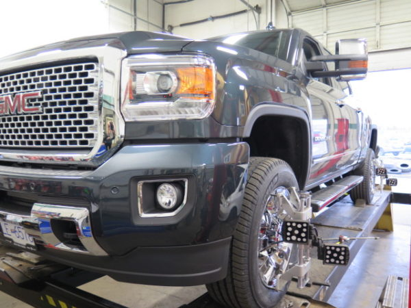 2017 GMC Denali 3500 in for TRUXXX Level off kit and FOX Shocks at Dales Auto Service