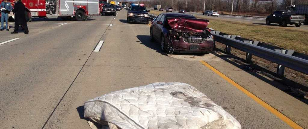Debris on Highway Causes Accident