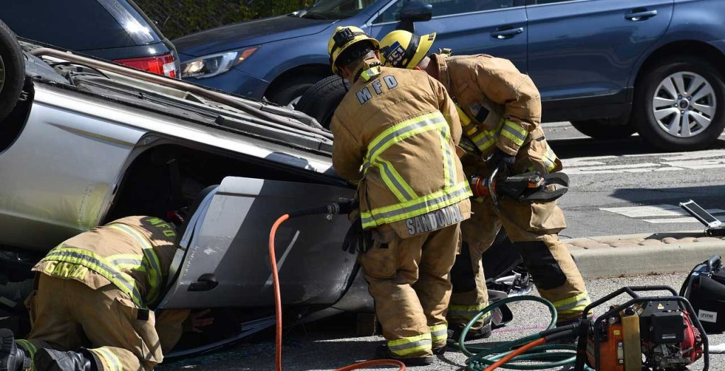 overturned car accident, EMS at scene, Right to Personal Injury Compensation