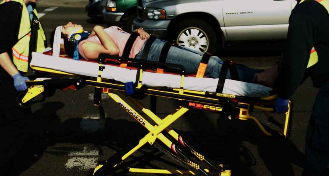 Paramedics taking a patient who has been injured by negligence. Dallas Personal Injury Attorney