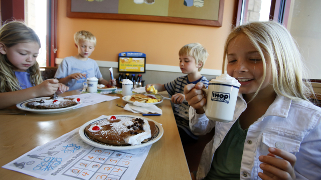Marley Abowitz, 9, right, with her siblings 7-year-old Brody, Aidan and Ruby, 6, sips on a drink at