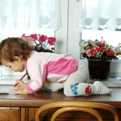 child_toddler_desk_climb_safety_danger_furniture_Dollarphotoclub_12102111