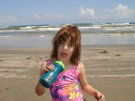 Kara Zartler at the beach in Galveston as a young girl. Her severe autism developed around age 4.