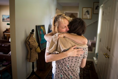 Christy Zartler hugs her daughter Kara at their Richardson home. (Smiley N. Pool/The Dallas Morning News)