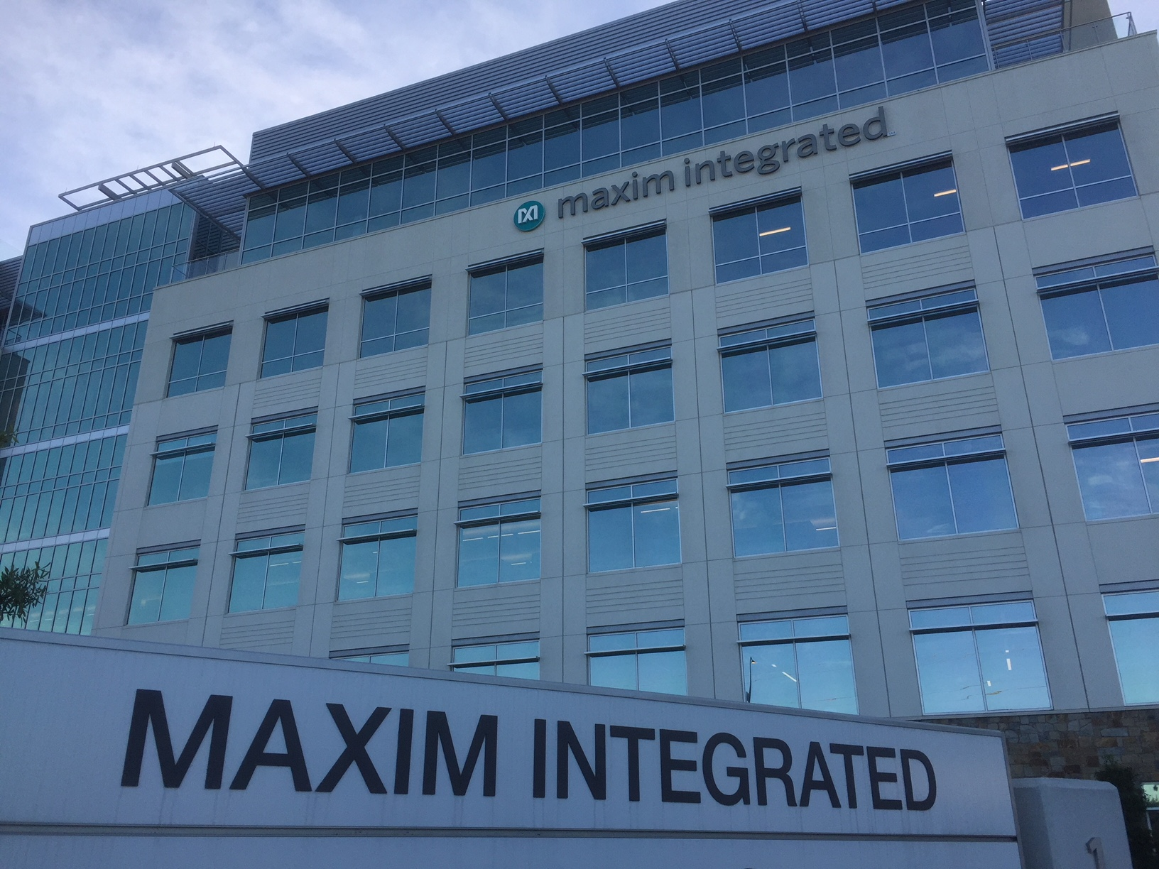 This is Maxim's new building in Addison, only a mile or so away from its old campus in Farmers Branch. In both cases, the company negotiated government giveaways. .