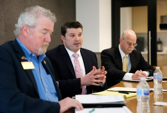 Dallas attorney J.J. Koch, center, answers questions in an editorial board meeting as former Garland City Council member Stephen Stanley (left) listens and former state District Judge Vickers