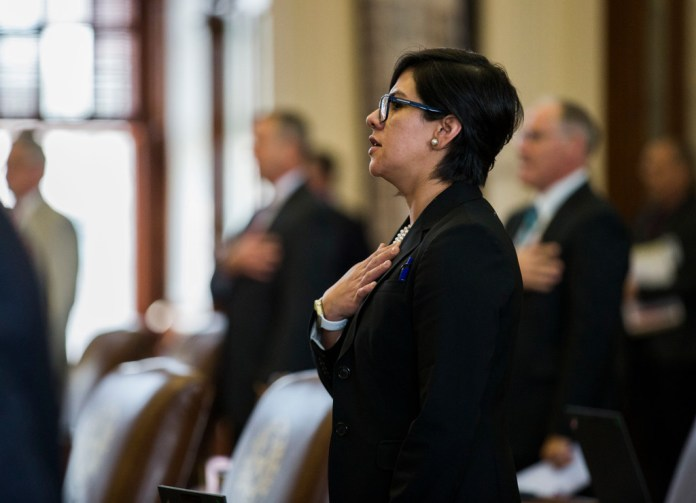 State Sen. Jessica Gonzalez recites the Pledge of Allegiance on the third day of the 86th Texas Legislature in Austin.(Ashley Landis/Staff Photographer)