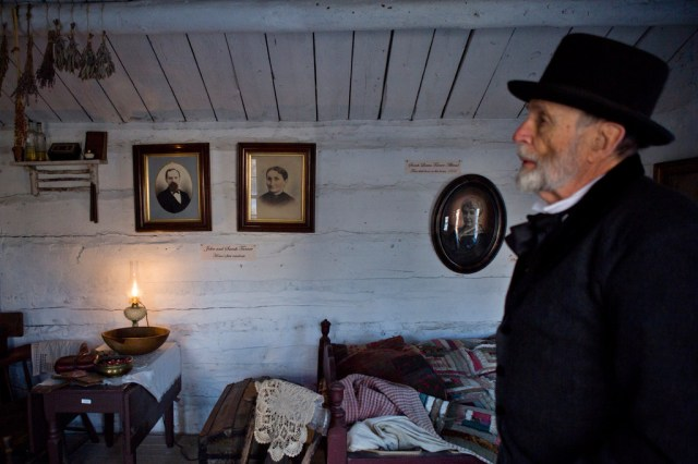 Stevens Nelson, the director of the Provo Pioneer Village, gives a tour of the open-air historical attraction.(Evan Cobb/The Washington Post)