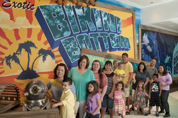 Children and parents view a brass dive helmet and crab trap near the Bikini Bottom mural before entering the Nickelodeon Spongebob Subpants Adventure inside the Discovery Pyramid at Moody Gardens in Galveston, Texas.