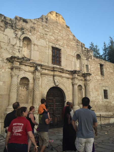 The tour guide explains what happened outside of the Alamo