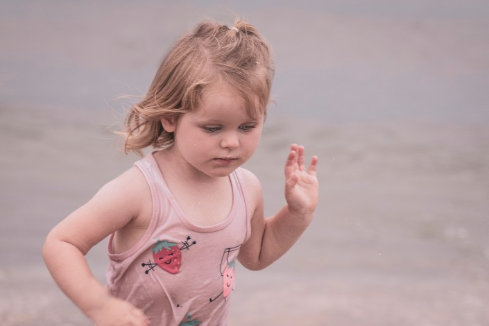 Young girl running on beach