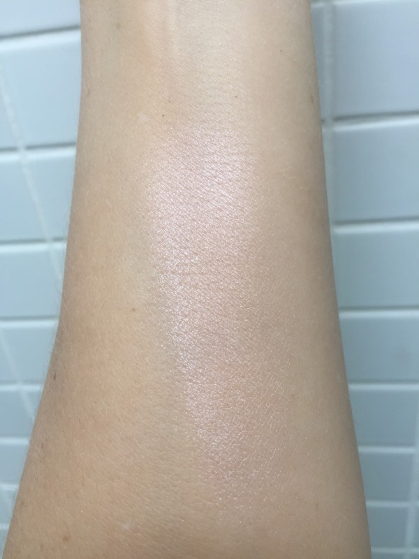 Hourglass Ambient Strobe Light Powder swatched in natural daylight