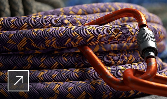 Coiled rope with carabiners in front of other bunches of rope