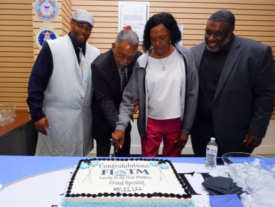 (Photo caption) FIATM Founder and CEO, Kuba Brown, Secretary, Wayne Brown, Donna B. Layne, and COO, David Jordan Layne, cut the cake at their recent Galleria at Tyler's Grand Opening in Riverside. The founder credited their parents with instilling in them a dedication to support and inspire family and community.