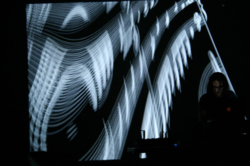 Catera performs in front of projection