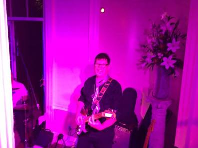 Rupert Blomfield playing guitar with The Disco Prophets