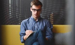 Man Writing or Reading