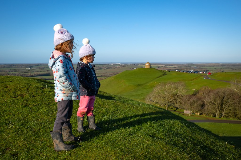 Lily and Chloe look out from the top of Magpie Hill