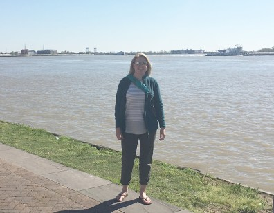 Standing on the bank of the Mississippi River in Jackson Square.
