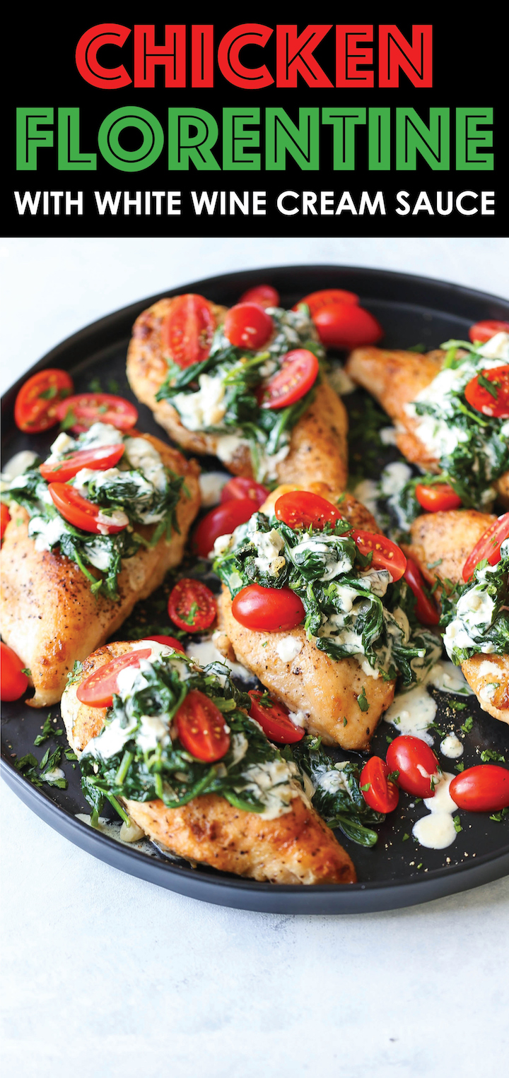 Chicken Florentine with White Wine Cream Sauce - Juicy chicken breasts topped with fresh spinach, tomatoes and a creamy white sauce that is AH-MAZING!