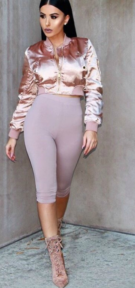 Amrezy wearing a pink satin womens bomber with cropped leggings and heels outfit