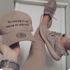 Yeezy sneakers tan leggings and tan baseball cap