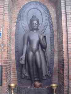Buddha carved out of a single dark stone