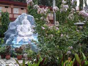 Shiva meditating in an ashram garden in Rishikesh