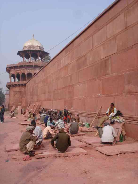 Maintaining the enormous red sandstone walls surrounding the Taj Mahal